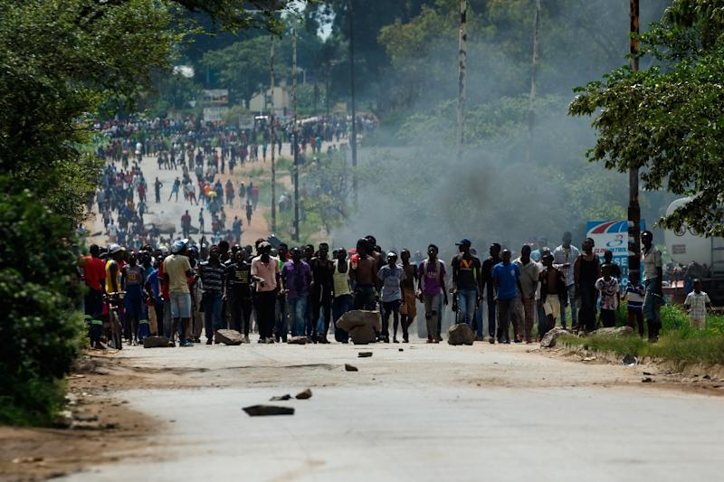 Nationwide demonstrations erupted after Zimbabwe's president announced that fuel prices were being more than doubled (AFP Photo/Jekesai NJIKIZANA)