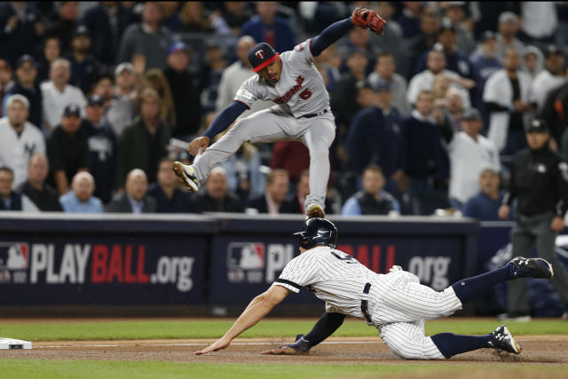 The Yankees-Twins wild-card game was truly wild, and people tuned in to watch the action. (AP Photo)