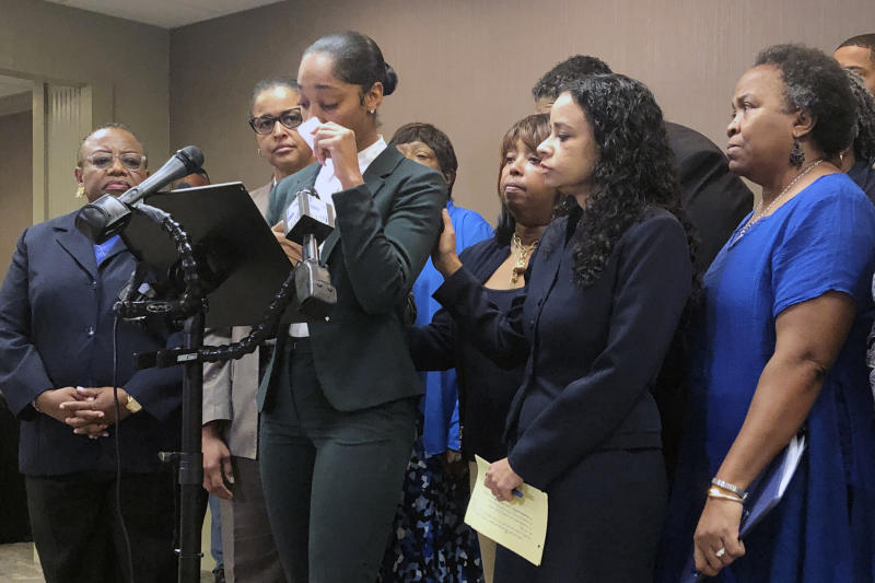 FILE - In this Sept. 25, 2019 file photo, Jazmyne Childs cries during a news conference as she describes the sexual harassment she says she endured while employed by the North Carolina chapter of the NAACP, in Raleigh, N.C. Emails and recordings obtained by The Associated Press show that the NAACP's national president chastised women who went public with a sexual harassment claim. The records also show that President Derrick Johnson was reluctant to swiftly deal with accusations against a former North Carolina officer in the civil rights organization. Johnson spoke in early October at the North Carolina state convention, less than two weeks after Childs said at a news conference that she had been sexually harassed in 2017. (AP Photo/Martha Waggoner, File)