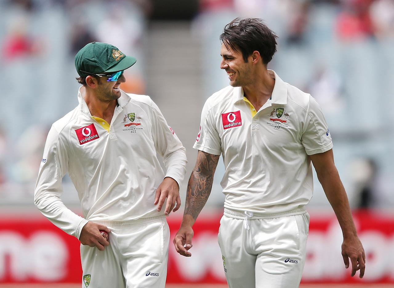 MELBOURNE, AUSTRALIA - DECEMBER 28:  Mitchell Johnson of Australia (R) talks with Nathan Lyon after a wicket during day three of the Second Test match between Australia and Sri Lanka at Melbourne Cricket Ground on December 28, 2012 in Melbourne, Australia.  (Photo by Michael Dodge/Getty Images)