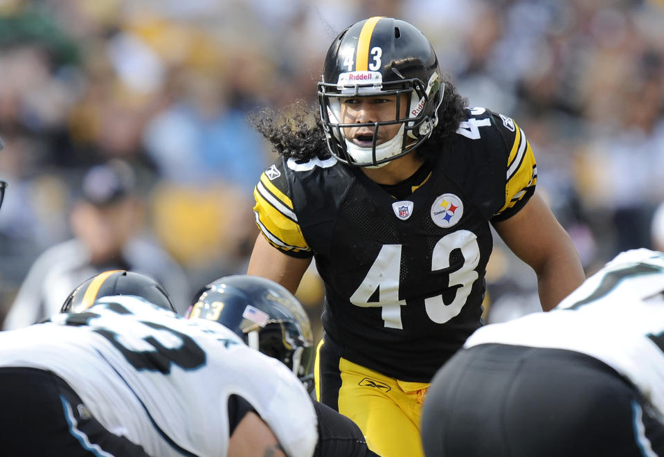 FILE - In this Saturday, Oct. 16, 2011, file photo, Pittsburgh Steelers strong safety Troy Polamalu (43) lines up against the Jacksonville Jaguars during the second quarter of a football game in Pittsburgh. His long hair — a tribute to his Samoan roots — spilling out from under his helmet onto the top of his No. 43 jersey, Polamalu careened from one side of the field to the next for 12 seasons in Pittsburgh. (AP Photo/Don Wright, File)