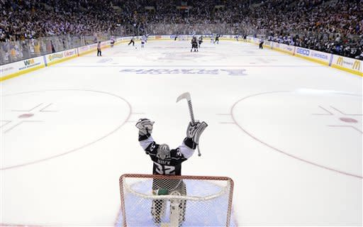 Los Angeles Kings goalie Jonathan Quick celebrates after the Kings scored an empty-net goal against the St. Louis Blues during the third period in Game 4 of an NHL hockey Stanley Cup second-round playoff series, Sunday, May 6, 2012, in Los Angeles. The Kings won 3-1 to win the series 4-0. (AP Photo/Mark J. Terrill)