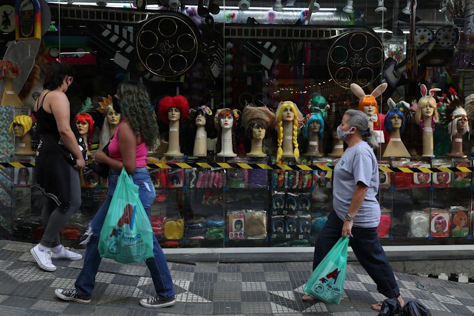 Women carry bags after shopping as the city hall eases restrictions and allows commerce to open amid the coronavirus disease (COVID-19) outbreak, in Sao Paulo, Brazil, June 11, 2020. REUTERS/Amanda Perobelli