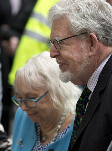 Veteran entertainer Rolf Harris with his wife Alwen, arrives at Westminster Magistrate's Court in London, Monday, Sept. 23, 2013. Harris faces nine counts of indecent assault on victims aged 14 and 15 and four counts of making indecent images. Harris, 83, has had musical hits, hosted television shows, painted an official portrait of the queen for her 80th birthday in 2006, and performed at the monarch's Diamond Jubilee concert last year. (AP Photo/Alastair Grant)