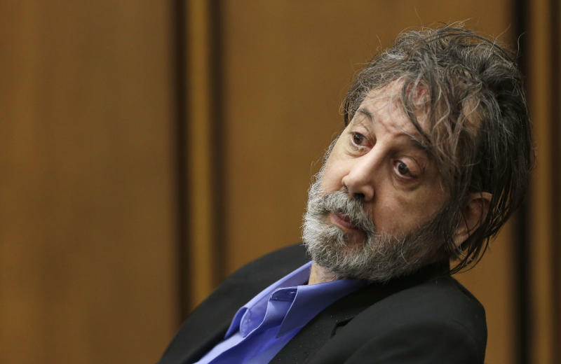 Bobby Thompson, who authorities have identified as Harvard-trained attorney John Donald Cody, looks at the jury during closing statements by the prosecution Wednesday, Nov. 13, 2013, in Cleveland. Thompson is charged with looting the United States Navy Veterans Association, a charity he ran from Tampa, Fla. The charity fraudulently registered with the state of Ohio in 2003 and made annual renewals, the prosecutor said. The charges include racketeering, money laundering, theft and identity theft.(AP Photo/Tony Dejak)