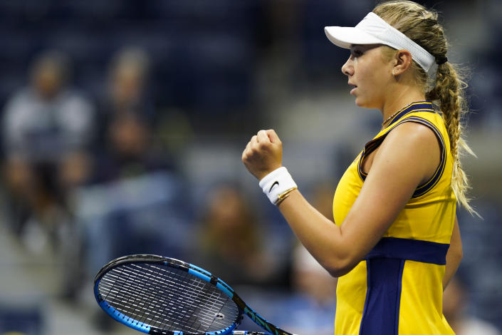 Amanda Anisimova, of the United States, reacts after scoring a point against Karolina Pliskova, of the Czech Republic, during the second round of the US Open tennis championships, Thursday, Sept. 2, 2021, in New York. (AP Photo/Frank Franklin II)