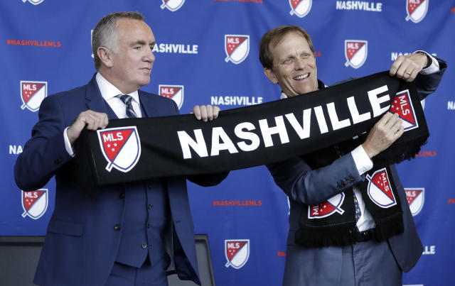 Ian Ayre, left, is introduced by John Ingram, right, the lead owner the Nashville, Tenn., MLS franchise, as the first chief executive officer of the team Monday, May 21, 2018, in Nashville. Ayre is a former CEO of the Liverpool Football Club of the English Premier League. (AP Photo/Mark Humphrey)