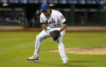 New York Mets relief pitcher Edwin Diaz (39) reacts after the final out against the Atlanta Braves during the ninth inning of a baseball game. Wednesday, June 23, 2021, in New York. (AP Photo/Noah K. Murray)