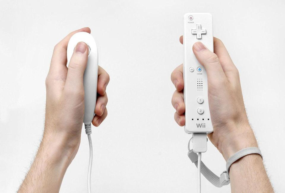 "<p>Ever the innovator, Nintendo once again introduced a completely new form factor for its controller and system, revolutionizing the way we play games. With the introduction of the Wii remote and Nunchuk accessory, Nintendo popularized motion control by way of offering a ""remote"" instead of a controller. </p><p>The Wii Remote's motion-sensing capability was brought to life via optical sensor bar that tracked player movements. Players could move the remote around and point at things onscreen, then press buttons on the remote to execute actions. The included Nunchuk was typically used for exploration or navigation. </p><p>The Wii Remote was meant to be held like a traditional remote, with a small power button, directional pad, a large A button, ""plus"", ""Home"", and ""minus"" buttons, a speaker, and ""1"" and ""2"" buttons. On the back a trigger was available. For some games, the Wii Remote could be turned horizontally to play. Most games relied on the Nunchuk to be plugged into the bottom of the remote.</p>"