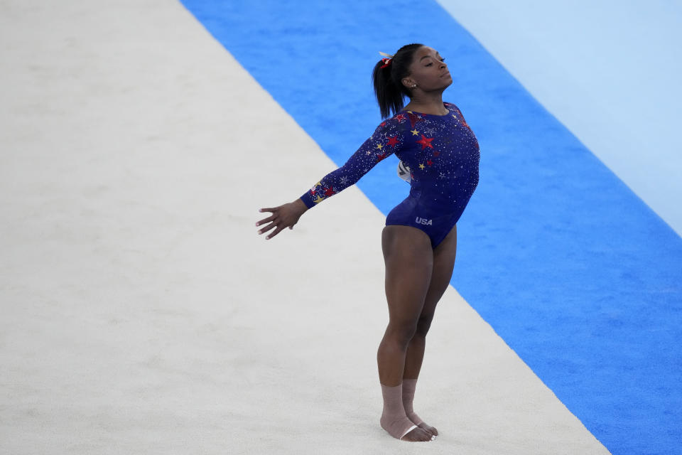 Simone Biles, of United States, performs her floor exercise routine during the women's artistic gymnastic qualifications at the 2020 Summer Olympics, Sunday, July 25, 2021, in Tokyo. (AP Photo/Ashley Landis)