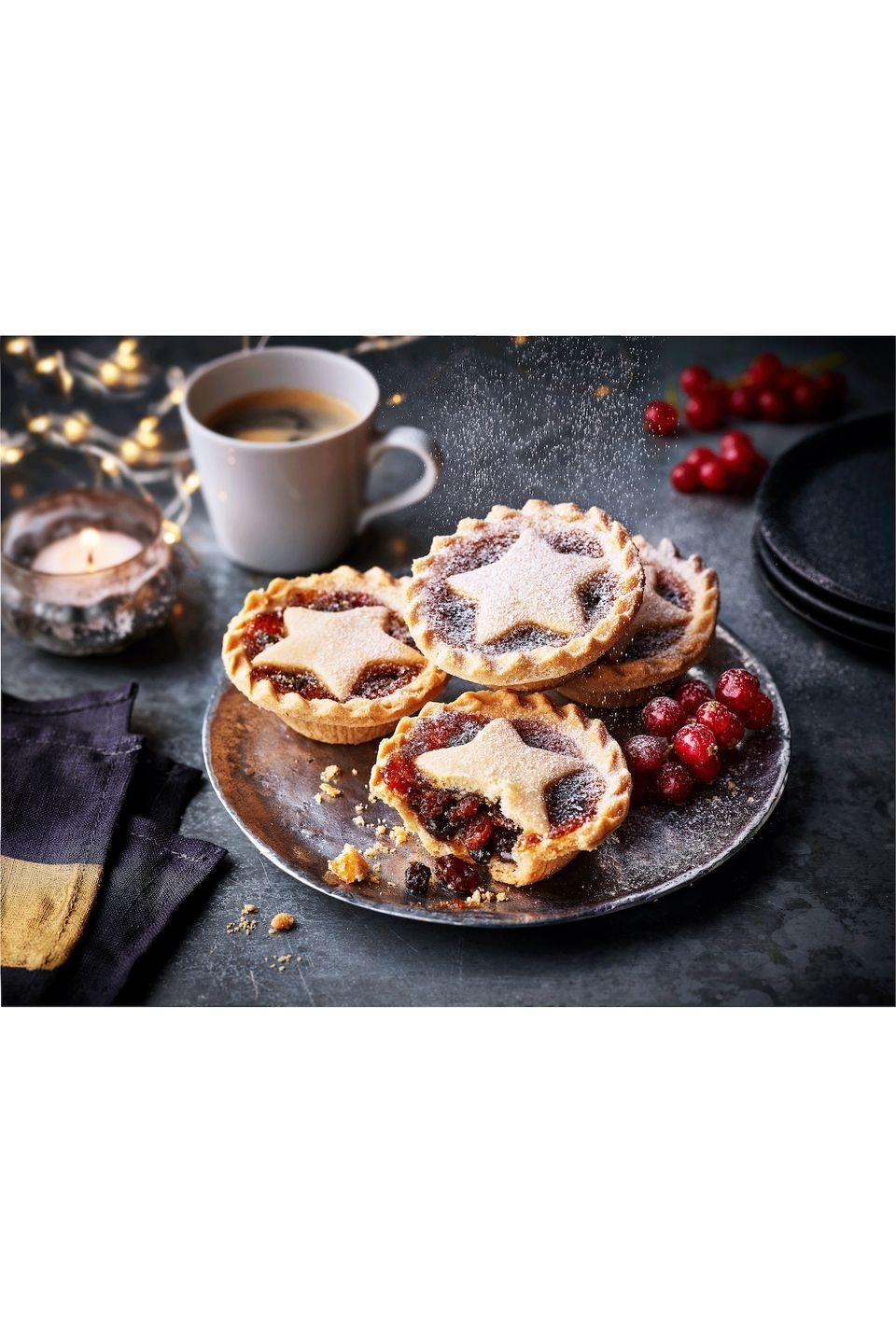 "<p><strong>Overall score: 72/100 </strong></p><p>These gluten-free mince pies have a festive star design, and a rich and buttery aroma. The mincemeat has a good ratio of vine fruits to sweet candied peel, while the pastry has a good thickness and a slight shortbread crumble to it. </p><p><a class=""link rapid-noclick-resp"" href=""https://christmasfood.marksandspencer.ie/#intid=IE_Christmas_lp_circle_food"" rel=""nofollow noopener"" target=""_blank"" data-ylk=""slk:AVAILABLE IN STORE ONLY"">AVAILABLE IN STORE ONLY</a> <strong>M&S, £2.50 for 205g (serves 4)</strong></p>"