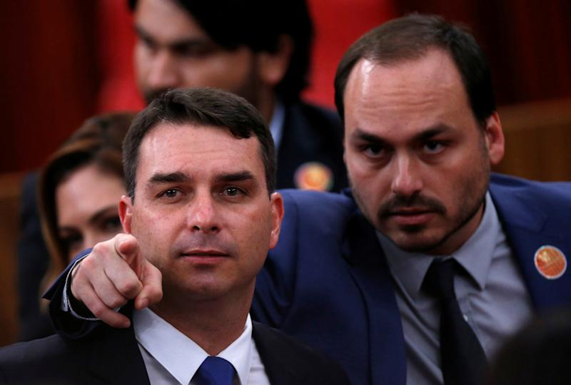 Flavio Bolsonaro (L) and Carlos Bolsonaro, sons of the Brazil's President-elect Jair Bolsonaro (not pictured) are seen before their father received a confirmation of his victory in the recent presidential election in Brasilia, Brazil December 10, 2018. REUTERS/Adriano Machado