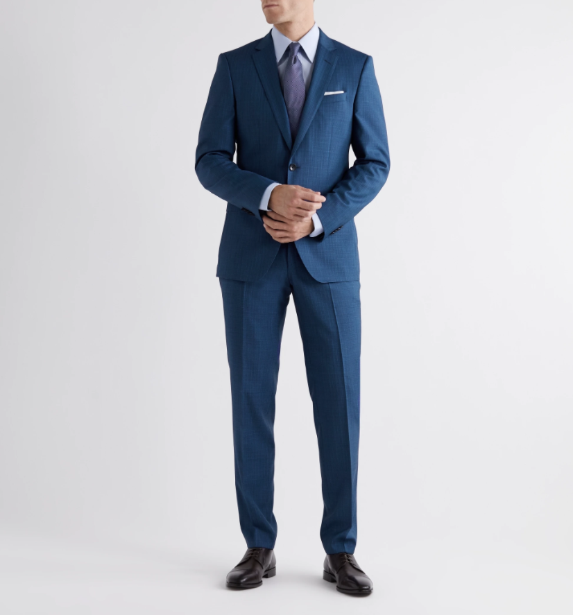 """<p><strong>HUGO BOSS</strong></p><p>Mr. Porter</p><p><strong>$795.00</strong></p><p><a href=""""https://go.redirectingat.com?id=74968X1596630&url=https%3A%2F%2Fwww.mrporter.com%2Fen-us%2Fmens%2Fproduct%2Fhugo-boss%2Fclothing%2Fsuits%2Fhugegenius-checked-wool-suit%2F10516758728586220&sref=https%3A%2F%2Fwww.esquire.com%2Fstyle%2Fmens-fashion%2Fg34385982%2Ffall-wardrobe-essentials%2F"""" rel=""""nofollow noopener"""" target=""""_blank"""" data-ylk=""""slk:Shop Now"""" class=""""link rapid-noclick-resp"""">Shop Now</a></p><p>If you haven't pulled a suit out of your closet since March 13 (guilty!), it's probably time for a refresh. You'll be looking fly at your first post-quarantine occasion in this blue checked variation from Hugo Boss' Huge/Genius collection. This classic all-season suit is sharply tailored to a slim silhouette, complete with shoulder padding for structure and two-button closure. The trousers come unhemmed for complimentary alterations at any Hugo Boss retail location. </p>"""