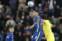 Chelsea's Christian Pulisic, left, jumps for a header with Villarreal's Pau Torres during the UEFA Super Cup soccer match between Chelsea and Villarreal at Windsor Park in Belfast, Northern Ireland, Wednesday, Aug. 11, 2021. (AP Photo/Peter Morrison)