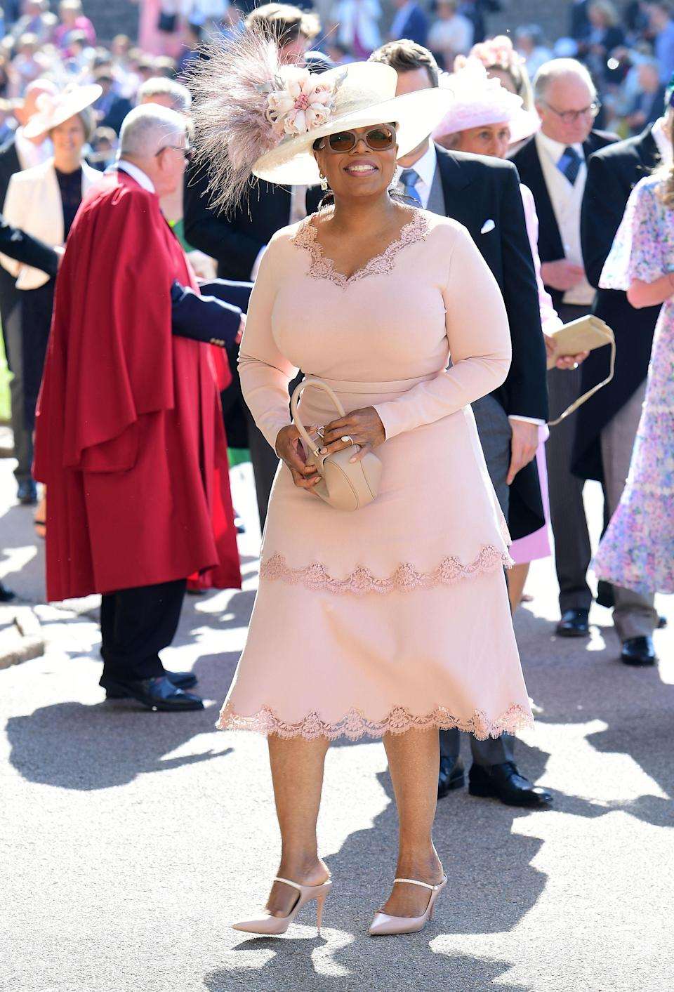 <p>The media owner and talk show host is wearing a Philip Treacy hat and Stella McCartney look. Winfrey goes to church with Doria Ragland, Meghan's mother. <em>[Photo: PA]</em> </p>