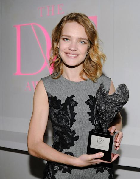 This April 5, 2013 photo released by The DVF Awards shows model Natalia Vodianova with her DVF Award in New York. Vodianova was recognized for her charity with children in her native Russia. She founded a charity called the Naked Heart Foundation in 2004. It started as a project to build a playground for the surviving children of the Beslan school massacre. Since then, it has grown to 90 play parks in 68 Russian towns. (AP Photo/The DVF Awards, Neil Rasmus)