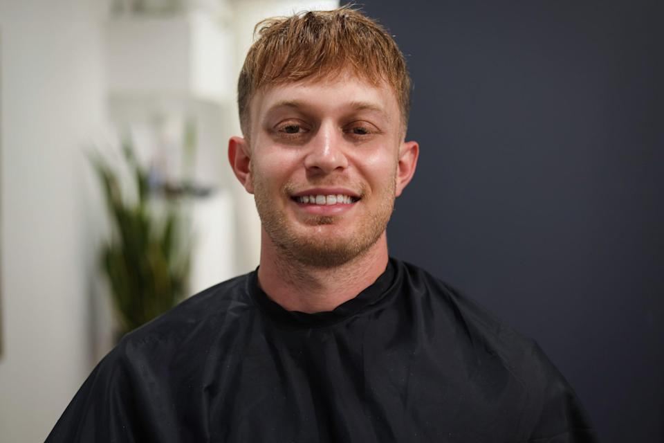 An after shot of a client at Prism Elites with a newly installed hair piece.