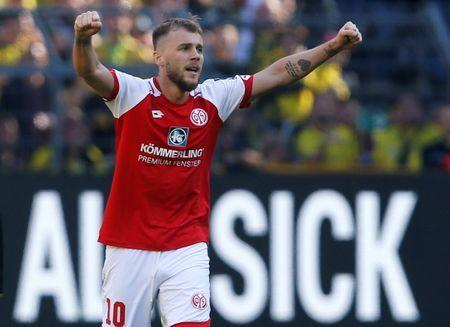 FILE PHOTO: Soccer Football - Bundesliga - Borussia Dortmund vs 1.FSV Mainz 05 - Signal Iduna Park, Dortmund, Germany - May 5, 2018 Mainz's Alexandru Maxim celebrates after the match REUTERS/Leon Kuegeler