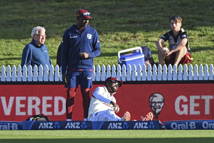 The West Indies Darren Bravo reacts after injuring himself during play on day one of the first cricket test against New Zealand in Hamilton, New Zealand, Thursday, Dec. 3, 2020. (Andrew Cornaga/Photosport via AP)