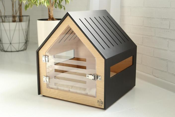 This modern crate will help your canine companion be the king or queen of their very own castle. This house-shaped sleeping quarters comes with a see-through acrylic door, so plenty of light gets in for your dog to be able to observe their surroundings, while still feeling safe in their personal space. There are oodles of ventilation holes and it comes with a thick, cream-colored cushion. The crates can be furnished with custom paint jobs, including the addition of your dog's name to the front panel.