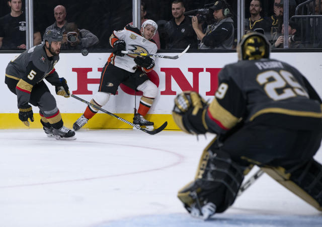 Vegas Golden Knights defenseman Deryk Engelland (5) defends agaomst Anaheim Ducks center Brian Gibbons (23), who shoots during the third period of an NHL hockey game Wednesday, Nov. 14, 2018, in Las Vegas. The Knights defeated the Ducks 5-0. (AP Photo/Eric Jamison)