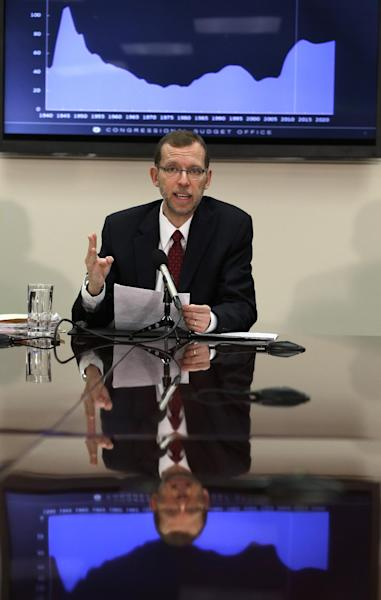 Congressional Budget Office Director Douglas Elmendorf gestures as he speaks about the office's annual Budget and Economic Outlook during a news conference at the Ford House Office Building in Washington, Tuesday, Feb. 5, 2013. The federal budget deficit will drop below $1 trillion for the first time in President Barack Obama's tenure in office, a new report said Tuesday. (AP Photo/Jacquelyn Martin)