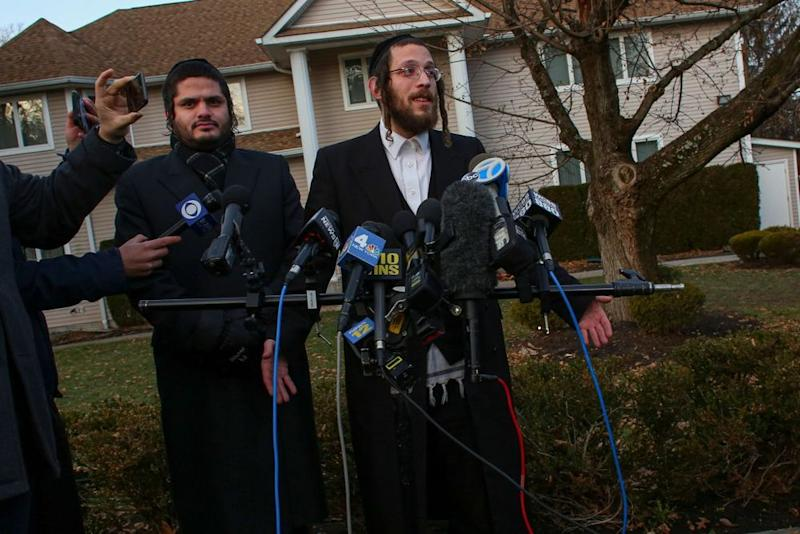 Joseph Gluck talks to the press as he describes the machete attack | KENA BETANCUR/AFP via Getty Images