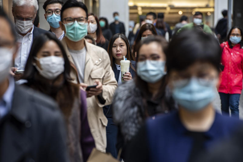 Pedestrians wear face masks in Central district of Hong Kong. The death toll from the covid-19 coronavirus epidemic past 1, 100 and infected over 45, 000 people worldwide on February 12. (Photo by Miguel Candela / SOPA Images/Sipa USA)