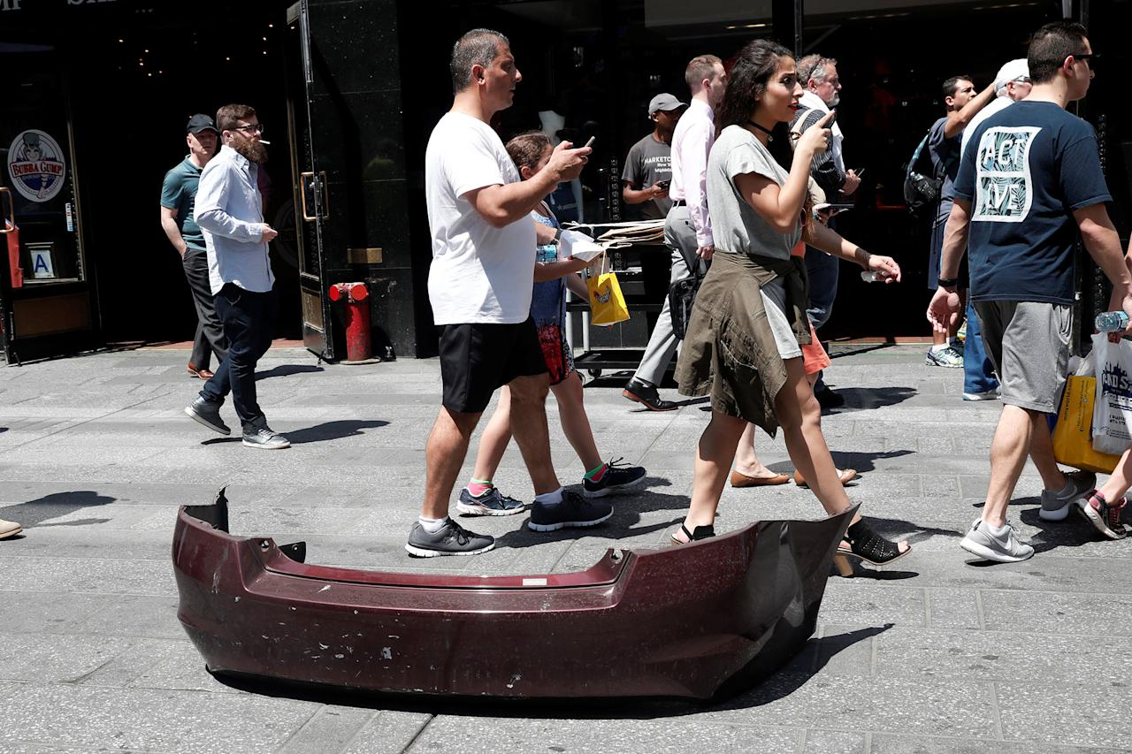 <p>A bumper from a vehicle that struck pedestrians and later crashed in Times Square is seen on the sidewalk in New York City on May 18, 2017. (Mike Segar/Reuters) </p>