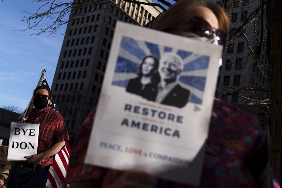 Joe Biden supporters celebrate the election results at a rally in Detroit