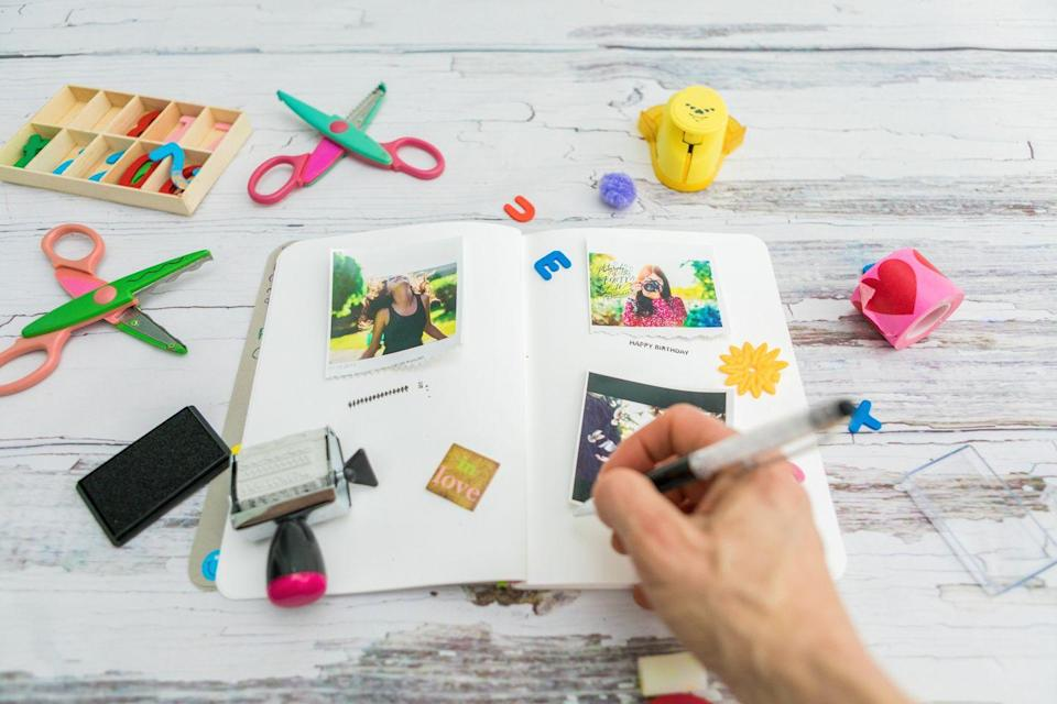 """<p>A scrapbook is a great gift for moms. Fill it with pictures and stories from the whole family. Your mom will love coming back to look through this thoughtful photo album again and again. </p><p><a class=""""link rapid-noclick-resp"""" href=""""https://www.amazon.com/gp/slredirect/picassoRedirect.html/ref=pa_sp_atf_aps_sr_pg1_1?ie=UTF8&adId=A09511073HWIE2RK9A8QP&url=%2FAdhesive-Magnetic-Scrapbook-Hardcover-Metallic%2Fdp%2FB07L4F224G%2Fref%3Dsr_1_1_sspa%3Fdchild%3D1%26keywords%3DSCRAPBOOK%26qid%3D1605822096%26sr%3D8-1-spons%26psc%3D1&qualifier=1605822095&id=4466288707002381&widgetName=sp_atf&tag=syn-yahoo-20&ascsubtag=%5Bartid%7C10063.g.34832092%5Bsrc%7Cyahoo-us"""" rel=""""nofollow noopener"""" target=""""_blank"""" data-ylk=""""slk:SHOP SCRAPBOOKS"""">SHOP SCRAPBOOKS</a></p>"""
