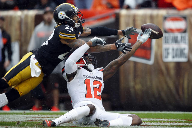 FILE - In this Sunday, Sept. 9, 2018, file photo, Cleveland Browns wide receiver Josh Gordon (12) and Pittsburgh Steelers defensive back Joe Haden (23) reach for the ball during an NFL football game in Cleveland. In a slopfest of an opener, the Steelers and Browns drew 21-21. (Jeff Haynes/AP Images for Panini, File)