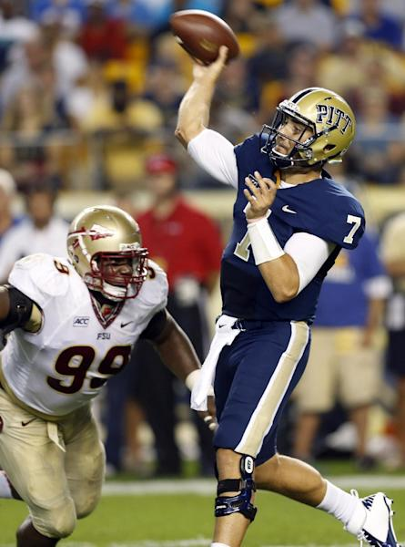 Pittsburgh quarterback Tom Savage (7) gets off a pass as Florida State defensive tackle Nile Lawrence-Stample (99) pressures in the first quarter of the NCAA college football game, Monday, Sept. 2, 2013, in Pittsburgh. (AP Photo/Keith Srakocic)