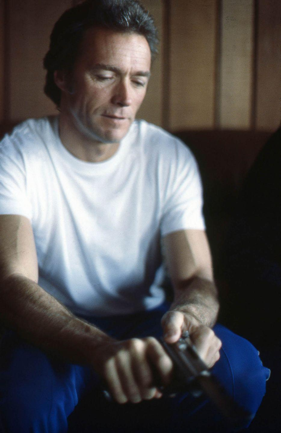 <p>Clint Eastwood holds a firearm at home in Pebble Beach in 1978.</p>
