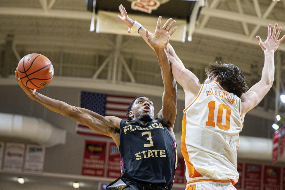 Florida State guard Trent Forrest (3) moves the arm of Tennessee forward John Fulkerson (10) to shoot in the second half of an NCAA college basketball game at the Emerald Coast Classic in Niceville, Fla., Friday, Nov. 29, 2019. (AP Photo/Mark Wallheiser)