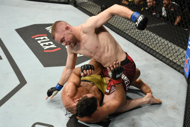 (R-L) Tristan Connelly punches Michel Pereira in their middleweight bout during the UFC Fight Night event at Rogers Arena on Sept. 14, 2019 in Vancouver, Canada. (Jeff Bottari/Zuffa LLC)