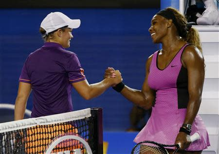 Serena Williams of the United States shakes hands with Ashleigh Barty of Australia after defeating her in their women's singles match at the Australian Open 2014 tennis tournament in Melbourne January 13, 2014. REUTERS/David Gray