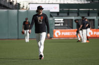 San Francisco Giants pitcher Kevin Gausman warms up before Game 1 of a baseball National League Division Series against the Los Angeles Dodgers Friday, Oct. 8, 2021, in San Francisco. (AP Photo/John Hefti)