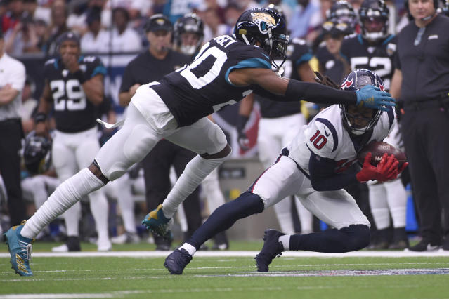 Texans wide receiver DeAndre Hopkins makes a catch in front of Jaguars cornerback Jalen Ramsey on Sunday. (AP)