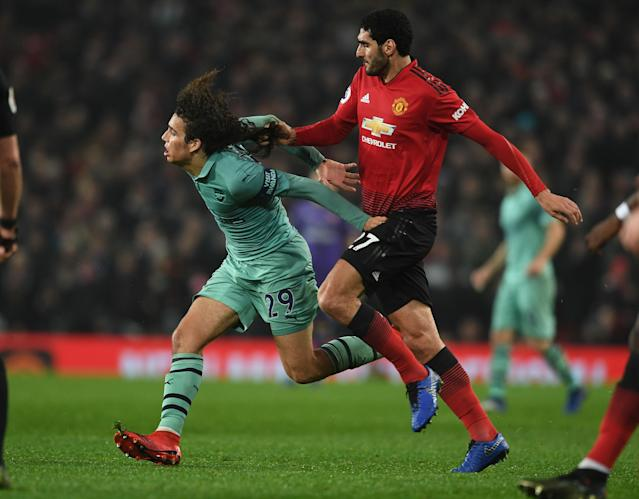 Marouane Fellaini escaped a card for pulling Matteo Guendouzi's hair at Old Trafford