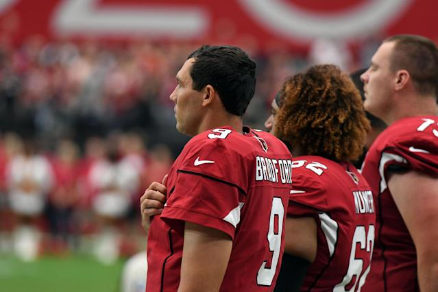 <p>Quarterback Sam Bradford #9 stands with teammate center Daniel Munyer #62 of the Arizona Cardinals for the National Anthem before the game against the Washington Redskins at State Farm Stadium on September 9, 2018 in Glendale, Arizona. (Photo by Norm Hall/Getty Images) </p>