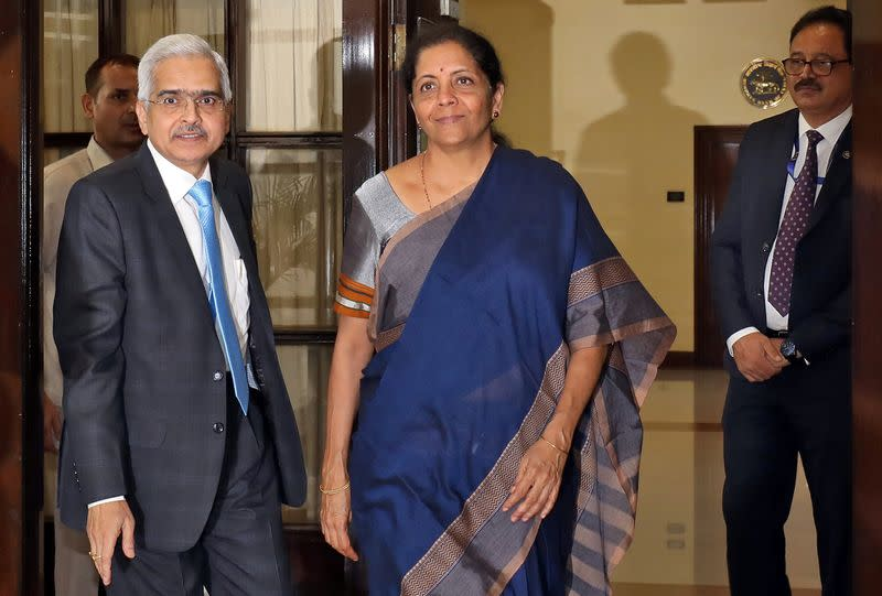 India's Finance Minister Sitharaman and the Reserve Bank of India Governor Das arrive to attend the RBI's central board meeting in New Delhi