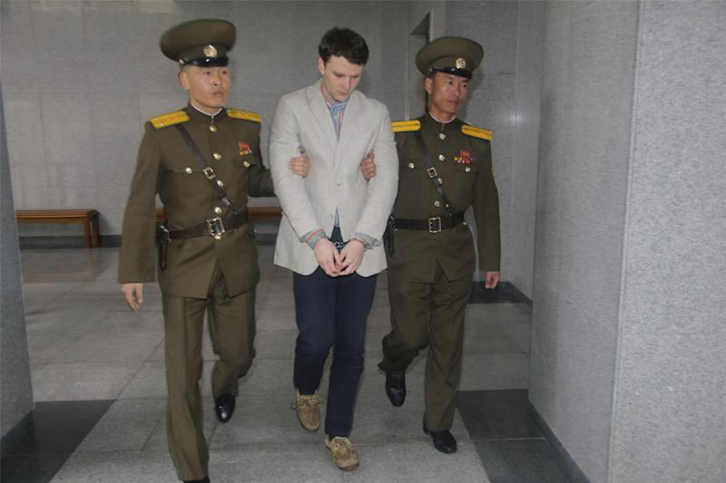American student Otto Frederick Warmbier arrives at a court for his trial in Pyongyang, capital of the Democratic People's Republic of Korea, on March 16, 2016. (Xinhua News Agency via Getty Images)