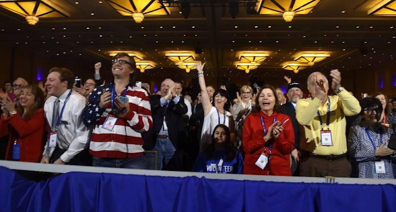 People cheer as US President Donald Trump addresses the Conservative Political Action Conference (CPAC) at National Harbor, Maryland, on February 24, 2017 (AFP Photo/Nicholas Kamm                       )