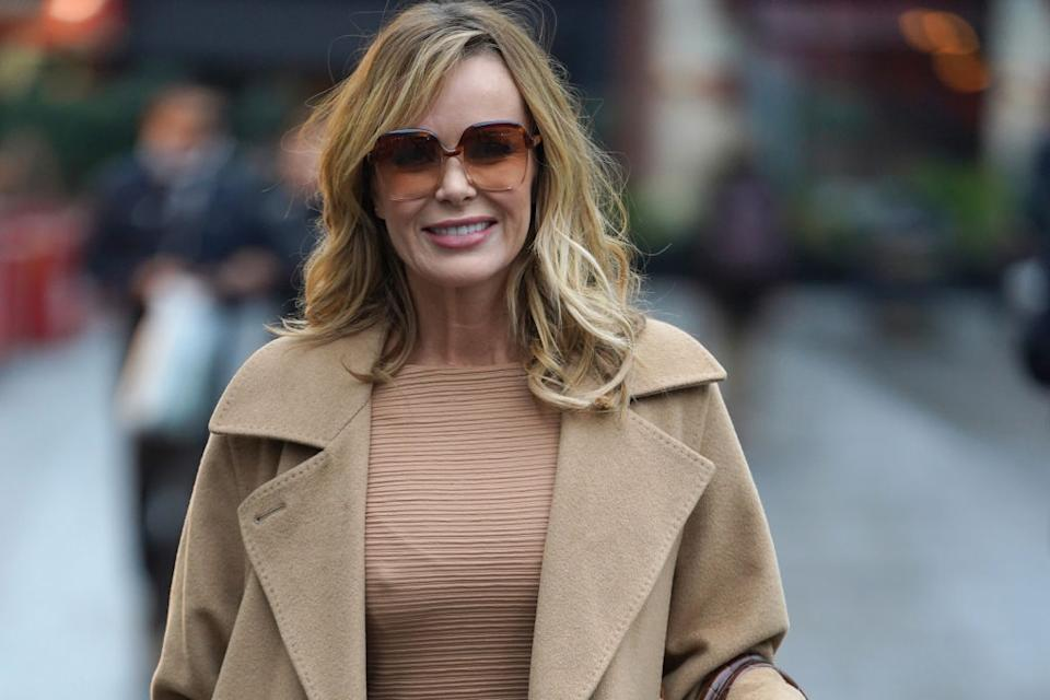 Amanda Holden is giving us all the lockdown lols by mowing the lawn in her wedding dress. (Getty Images)
