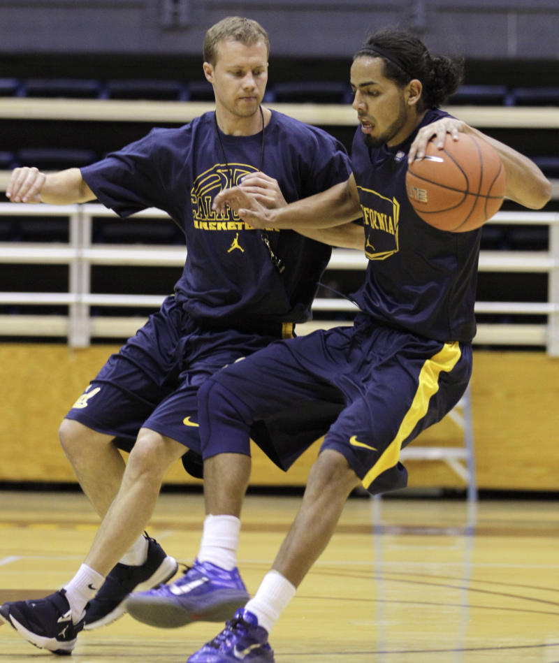 In this Oct. 18, 2011, photo, California assistant men's basketball coach John Montgomery, left, works out with Jorge Gutierrez in Berkeley, Calif.  Several years after being dropped off in Denver to live with three other undocumented Mexican teens determined to build a future, the fiery Gutierrez landed almost by accident at California as fourth-year coach Mike Montgomery's first recruit. (AP Photo/Ben Margot)