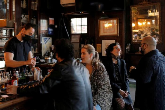 FILE PHOTO: Restrictions ease for bars, allowing seating at the bar, during the coronavirus disease (COVID-19) in Manhattan, New York City.