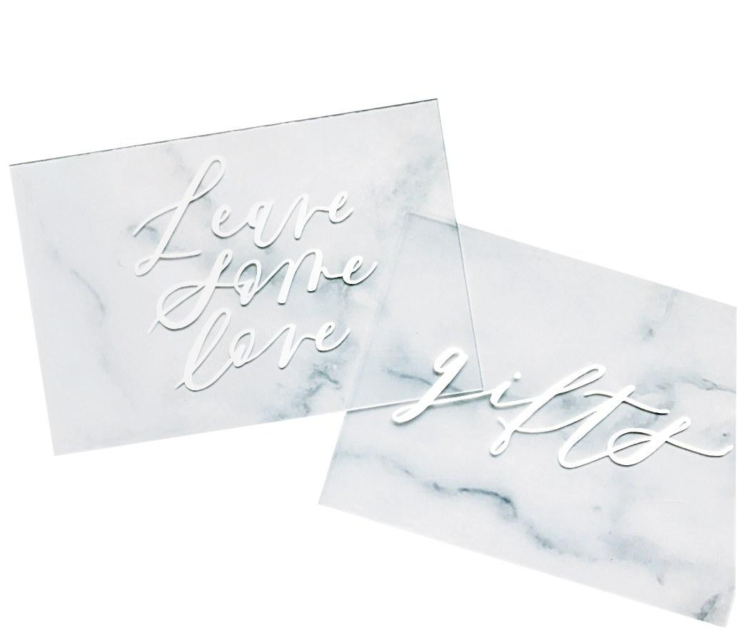 "<p>""Acrylic <a rel=""nofollow"" href=""http://www.brides.com/gallery/escort-cards-that-use-guest-photos?mbid=synd_yahoolife"">seating cards</a> with Alli K Design's beautiful, unique calligraphy will make your escort table feel fresh and intriguing."" <em>(From $20 each, <a rel=""nofollow"" href=""http://www.allikdesign.com?mbid=synd_yahoolife"">Alli K Design</a>)</em></p>"