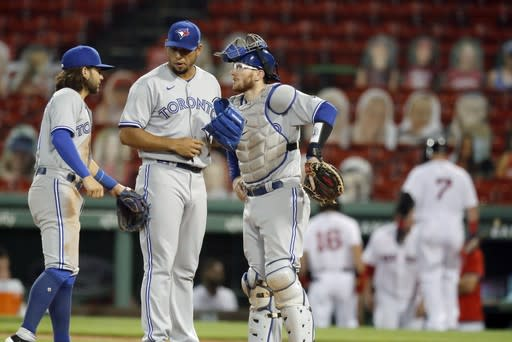 Toronto Blue Jays' Bo Bichette, left, and Danny Jansen, right, talk with Wilmer Font on the mound during the fourth inning of a baseball game against the Boston Red Sox, Saturday, Aug. 8, 2020, in Boston. (AP Photo/Michael Dwyer)