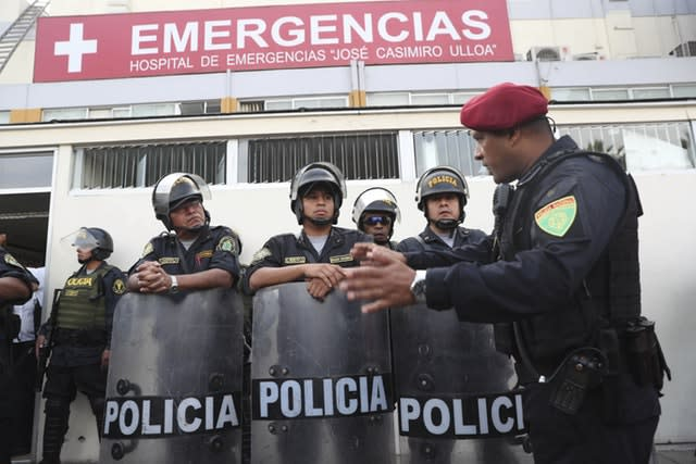 Peru's police officers stand guard at the hospital where former president Alan Garcia was taken